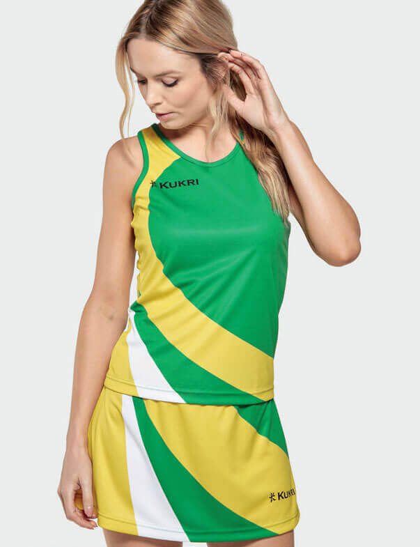 Woman in Green and Yellow Netball Kit