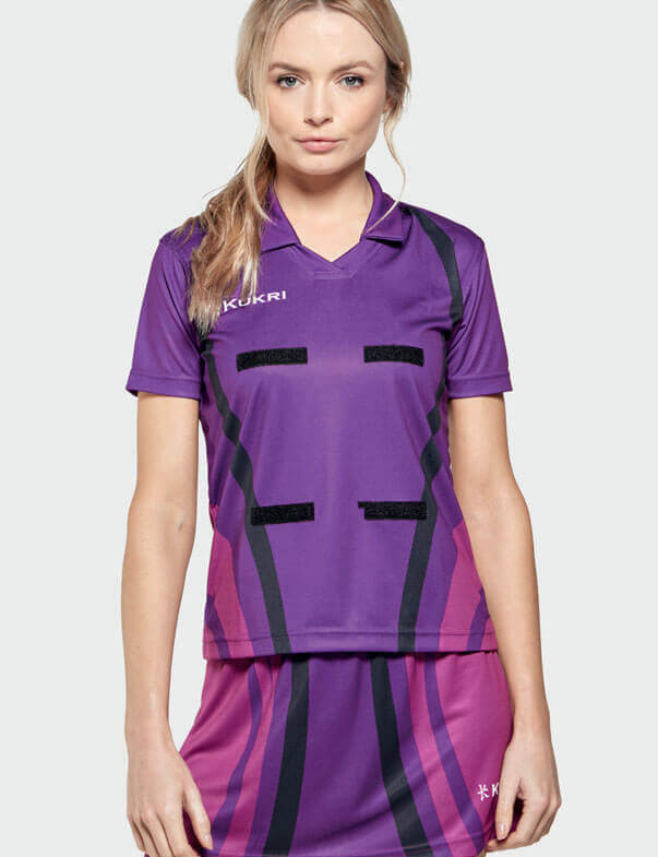 Woman in Purple and Pink Netball Kit